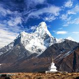 Mount Ama Dablam with stupa near Pangboche village. And beautiful cloudy sky - way to mount Everest base camp - Khumbu valley - Nepal Stock Photography