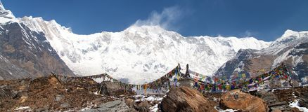 Mount Annapurna with buddhist prayer flags Stock Photo