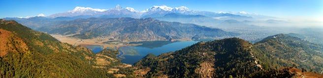 Mount Annapurna, Dhaulagiri and Manaslu panorama. Panoramic view of mounts Annapurna, Dhaulagiri and Manaslu himalayan range, Pokhara and Phewa lake, Pokhara stock photo