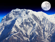 Mount Annapurna South and the Moon. Image of Mount Annapurna South on the Dhaulagiri-Annapurna-Manaslu Himalayan Mountain Range, Nepal, against a backdrop of a royalty free stock photography