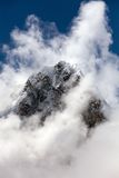 Mount Arakam Tse and clouds near Cho La Pass Royalty Free Stock Photography