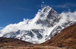 Mount Arakam Tse, Nepal Himalayas mountains. Mount Arakam Tse and clouds near Cho La Pass, beautiful mount on the way to Everest base camp, three passes trek Royalty Free Stock Photo