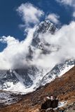 Mount Arakam Tse, Nepal Himalayas mountains. Mount Arakam Tse and clouds near Cho La Pass, beautiful mount on the way to Everest base camp, three passes trek Royalty Free Stock Images