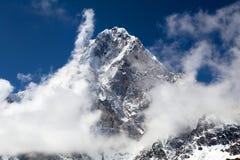Mount Arakam Tse, Nepal Himalayas mountains. Mount Arakam Tse and clouds near Cho La Pass, beautiful mount on the way to Everest base camp, three passes trek Stock Photo