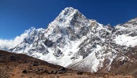 Mount Arakam Tse, Nepal Himalayas mountains. Mount Arakam Tse and clouds near Cho La Pass, beautiful mount on the way to Everest base camp, three passes trek Stock Photography