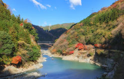 Mount Arashiyama and Oi river in Autumn season. Kyoto Japan Royalty Free Stock Photo