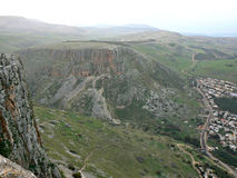 Mount Arbel. A flat-top mountain with steep cliff-like slopes, seen as the summit of Mount Arbel in Galilee, Israel. The gap between both mountains forms a Royalty Free Stock Photography