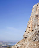 Mount arbel and historic caves with sea of galilee Stock Photography