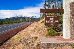 Mount Bachelor sign by road Stock Photos