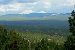 Mount Bachelor and Tumalo Mountain. Suburbs are intermixed within evergreen forest in this shot from Overturf Butte on the west side of Bend, Oregon.  Mount Stock Photography