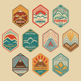 Mount badge set1color. Set of retro-colored alpinist and mountain climbing outdoor activity  logos. Logotype templates and badges with mountains, peaks, creeks Royalty Free Stock Image