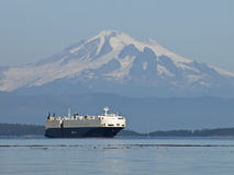 Mount Baker and Ocean Freighter. A huge car freighter passing by Mount Baker. Taken from a boat in the Gulf Island of British Columbia, Canada Royalty Free Stock Photos