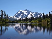 MOUNT BAKER REFLECTION IN A SPARKLING ALPINE LAKE. Mount Baker in northern Washington was beautifully reflected in this alpine lake. The sun was out, but it was Stock Photo
