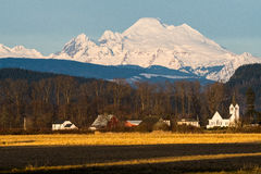 Mount Baker. Viewed across Skagit Valley, WA with Conway church in foreground Stock Photos
