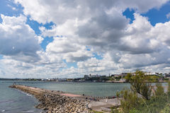 Mount Batten Breakwater. Looking across to Plymouth on a Summers afternoon royalty free stock image