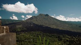 Mount Batur volcano view on sunny summer day in Bali, Indonesia stock footage
