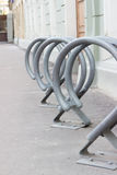 Mount for bicycle parking in the city. In line Stock Images