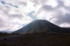 Mount Bromo, active volcano with cloudy sky at the Tengger Semeru National Park. Royalty Free Stock Photography
