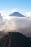 Mount Bromo, an active volcano surrounded by white clouds of mist in the morning at the Tengger Semeru National Park. Stock Photo