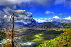Mount Bromo HDR. Mount Bromo (Indonesian: Gunung Bromo), is an active volcano and part of the Tengger massif, in East Java, Indonesia. At 2,329 metres (7,641 ft royalty free stock photos