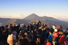 MOUNT BROMO, INDONESIA - JUNE 28, 2014: Undefined crowd of tourists watching sunrise over Bromo volcano Stock Photos