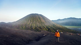 Mount Bromo in Indonesia. BROMO, INDONESIA - 2ND MARCH 2014; Unidentified traveller looking for a view around Bromo's area during walk back from crater in East Stock Images