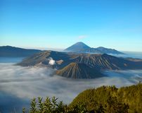 Mount Bromo. (Indonesian: Gunung Bromo), is an active volcano and part of the Tengger massif, in East Java, Indonesia. At 2,329 metres (7,641 ft) it is not the Stock Image