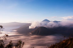 Mount Bromo surrounded by mist, an active volcano in East Java, Indonesia. Mount Bromo surrounded by mist, an active volcano and part of the Tengger Semeru Stock Photography