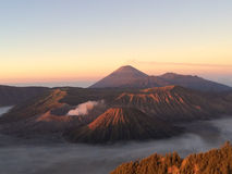 Mount Bromo volcano at dawn, East Java, Indonesia. Mount Bromo is the smoking crater among a group of other volcanoes. The one in the forefront is very recent Royalty Free Stock Photography
