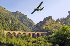 Mount Bulgheria. Airplane flying over railway bridge crossing Mount Bulgheria, Salerno, Italy Royalty Free Stock Images