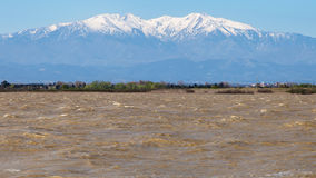 Mount Canigou from Canet lagoon Royalty Free Stock Images