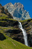 Mount Cervino and waterfall, Aosta Valley. Picturesque waterfall on the trail n.13 and a view of the majestic Matterhorn Stock Photo