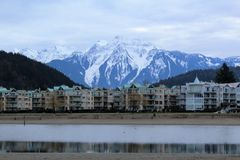 Mount Cheam Looms over Harrison Hot Springs Resort. The snow capped peaks of Mount Cheam loom over the scenic resort town of Harrison Hot Springs in the Fraser Royalty Free Stock Photography