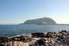 Mount, coast line & blue sky royalty free stock images