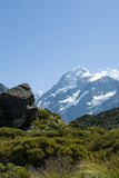 Mount Cook ahead, beyond the lush green valley Stock Photo