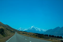 Mount Cook and Empty Road on a Sunny Day Royalty Free Stock Images