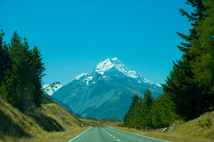 Mount Cook and Empty Road on a Sunny Day Stock Images