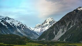 Mount Cook in the evening, fast-moving clouds and vanilla skies in time-lapse photography at Mount Cook National Park