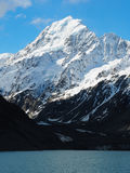 Mount Cook from Lake in New Zealand. The Valley Track offers impecable views of Mount Cook in the Spring. The snow melt ensures lots of landscape contrast and stock photography
