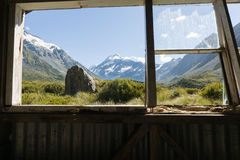 Mount Cook through hut window. Stock Photo