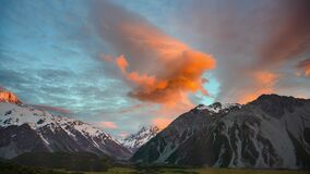 Mount Cook in the morning, fast-moving beautiful clouds and twilight skies in time-lapse photography at Mount Cook National Park