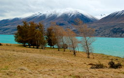 Mount Cook New Zealand. View of turquoise Lake Pukaki with snowy Mount Cook in the background Stock Photo