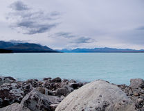 Mount Cook over a blue lake Stock Images