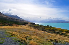 Mount Cook viewpoint with the lake Pukaki and road leading to mount cook village Royalty Free Stock Images