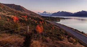 Mount cook viewpoint with the lake pukaki and the road leading to mount cook village. Taken during autumn in New Zealand stock photography