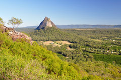 Mount Coonowrin from Mount Ngungun. Mount Coonowrin taken from the top of Mount Ngungun - Glasshouse Mountains in the Sunshine Coast hinterland, Queensland Stock Photos