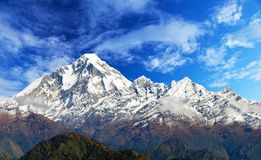 Mount Dhaulagiri with clouds on sky. Panoramatic view from Jaljala pass of Dhaulagiri Himal with clouds on sky - Guerrilla trek in Western Nepal Himalayas stock photos