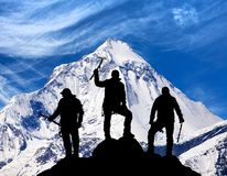 Mount Dhaulagiri and silhouette of group of climbers. View of mount Dhaulagiri and silhouette of group of climbers with ice axe in hand, Nepal stock photo