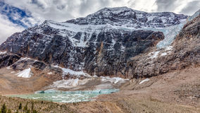 Mount Edith Cavell Landscape. Landscape view of Mount Edith Cavell in Jasper National Park, Alberta, Canada. With view of Angel glacier and meltwater lake with stock photo