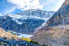 Mount Edith Cavell and Angel Glacier in Jasper National Park. Mount Edith Cavell, a mountain located in the Athabasca River and Astoria River valleys of Jasper stock photos